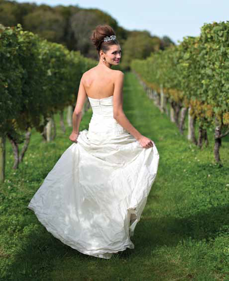 "Our Nicole Miller ""Mia"" gown is perfect for a rustic, wine country wedding!"